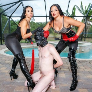 Brown-haired females Kylie Rogue and Michelle Lacy dominate a masked masculine submissive