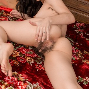 Brown-haired first-timer Luna O displays her furry armpits and full pubic hair at Christmas