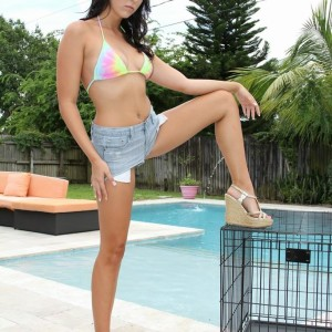 Brown-haired wife Adriana Lily pegs her sissy over a dog cage on poolside patio