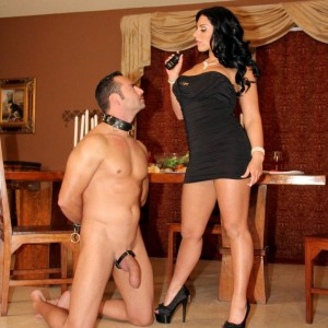 Dark haired mistress Bella Reese makes her male slave slurp out her butt-hole in high heels