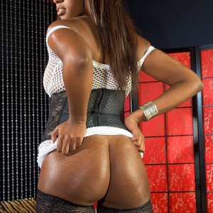 Ebony MILF Leah Ray flaunts her hefty ass during solo action in nylons and high-heels