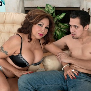 Elder dame Sandra Martines tempts a younger dude in boulder-holder and panties mixture