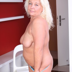 Elderly platinum-blonde BIG SEXY LADY disrobing out of mini-skirt and lingerie to pose overweight booty in the naked