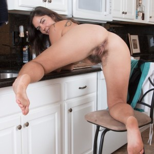 Euro amateur Katie Z demonstrating unshaven pits and all-natural pubic hair in kitchen