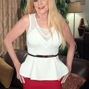 Experienced platinum-blonde gal Charlie has her large breasts unsheathed by junior stud in a crimson micro-skirt