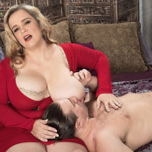 Fair-haired BBW Cami Cooper giving massage before unsheathing big titties for nipple gobbling