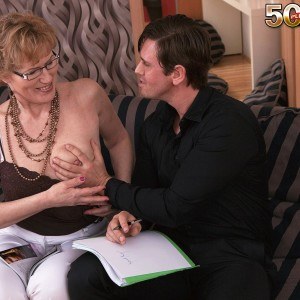 Granny in glasses entices a younger guy and deepthroats his dick on couch