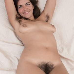 Hirsute brown-haired Katie Z takes off her onesie to make her naked modelling debut outdoors