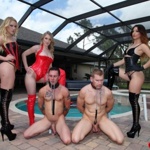 Jaw-dropping females in latex attire and hip high boots abuse collared male submissives by a pool