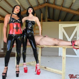 Latex outfitted Dommes Jean Bardot and Michelle Lacy torture a restricted male sub