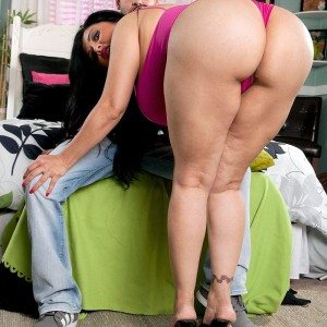 Latina female Daylene Rio seduces a guy with her plus-sized tush and giant breasts