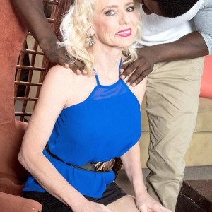 Long legged senior platinum-blonde doll Cammille Austin prepping for sex with gigantic ebony cock