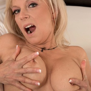 Mature blond dame eats and gargles on a huge cock in her ebony pantyhose