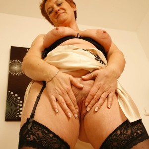 mature ginger-haired girlfriend pulls out enormous all natural titties after flashing no panty upskirt