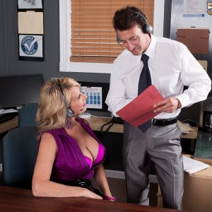 Older blonde lady Laura Layne seducing sex from co-worker in her office
