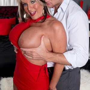 Over 50 MILF Sally D'Angelo having monster-sized boobies liberated from dress by junior boy