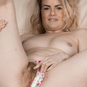 Platinum-blonde first-timer Rebecca Louise unsheathing little titties from boulder-holder before spreading vag