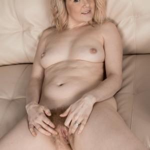 Platinum-blonde first-timer Rebecca Louise unsheathing little titties from boulder-holder before spreading vag