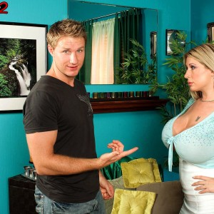 Platinum-blonde secretary Summer Sinn showcases her humungous titties at the work place in a long micro-skirt