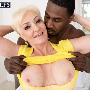 Platinum yellow-haired grannie Seka Black deep throats off a younger man's enormous ebony penis