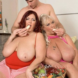 Plus-sized girls Shugar and Peaches LaRue providing lengthy penis blowjobs while eating food
