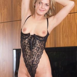 Sandy-haired amateur Ayda doffs black lingerie before showcasing her furry gash