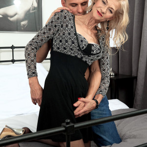 Sumptuous sandy-haired grandma Beata seduces a younger guy in a black miniskirt and hosiery