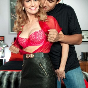 Super-sexy mature doll Denise Day seduces a younger man in leather skirt and nylons