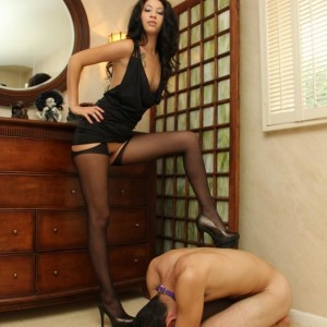 Uber-sexy wife Esmi Lee coerces her collared spouse to submit to her in a purity device