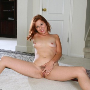 All natural red-haired grabs her uber-sexy ass before showing her shaven slit while alone