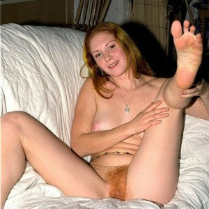 Bootless first-timer with rigid breasts touts her bare ass and hairy twat in her bedroom