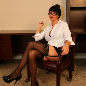 Brunette mistress Angie Noir possesses a whip before having her cunny adored