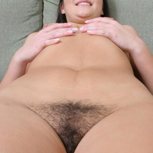 black-haired first timer touts her fabulous ass before showing the pinkish of her shaven gash