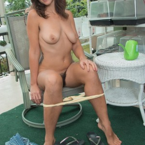 First timer stunner Katie Z demonstrates her unshaven armpits and cooter on her balcony