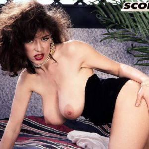 Aged adult movie star Diana Wynn lets out her monster-sized titties from her retro styled bra