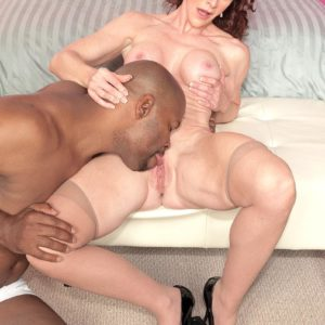 Beguiling grannie Catherine is freed from brassiere and panty set by her younger black lover
