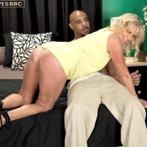 Blonde grandma Nikki Chevious works on seducing a black boy in a yellow sundress