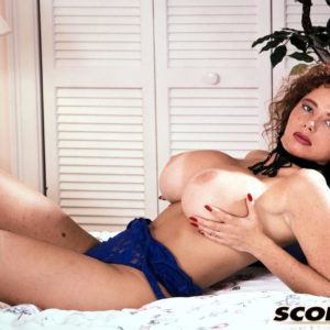 Classic X-rated film starlet Montana flaunts her immense boobies during solo activity