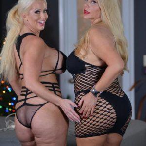 Curvy elder ash-blonde Karen Fisher and her lezzie girlfriend break out a sex toy on a bed