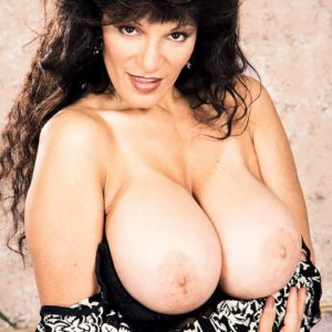 Elderly X-rated film star Big-titted BriAnna sets her hefty boobs free and her shaven beaver too