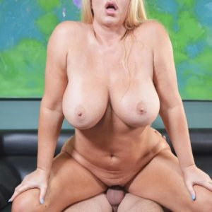 Enormous boobed blonde Karen Fisher gets on top a penis while having sex on a couch