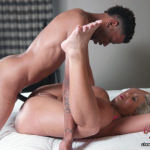 Giant titted platinum golden-haired Claudia Marie takes a ebony penis up her pooper atop a bed