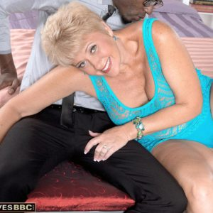 Insatiable grandmother Tracy Gobbles entices a junior ebony dude in a see through dress