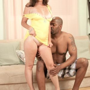 Inviting granny Gillian Sloan shows her bald cunny with help from ebony toy dude