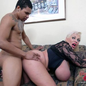Massive boobed platinum light-haired Claudia Marie participates in interracial sex on a sofa