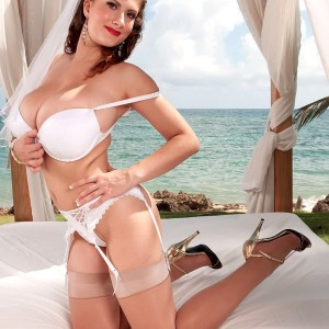 MILF XXX adult starlet Valory Irene models out on an oceanside lawn in her panties