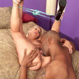 Platinum-blonde granny Andi Roxxx tongue kisses a ebony dude before having her vagina sucked