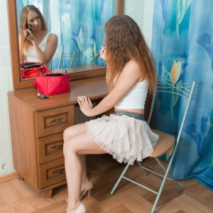 Red-haired first timer Nikky B touts her bubble bootie before parting her bald beaver