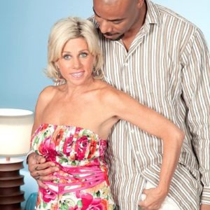 Seductive grannie Payton Hall is stripped to a pink thong by her junior black paramour