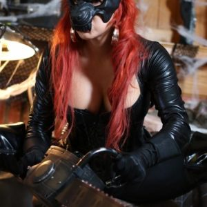 Solo model Karen Fisher releases her enormous boobs and booty from spandex apparel at Halloween